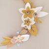 détail couronne de fleurs millimétre poudre origami pliage main